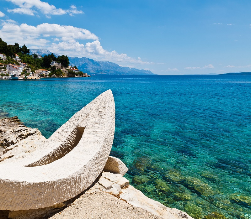 White beach with boat sculpture SPLIT shutterstock 91295060